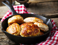 Chicken cutlets on frying pan. Royalty Free Stock Photography