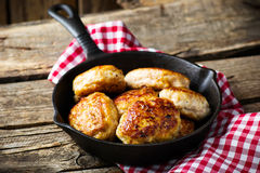 Chicken cutlets on frying pan. Stock Photography
