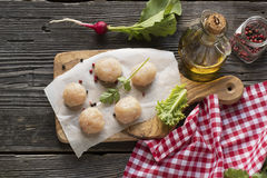 Chicken cutlets on frying pan. style rustic. selective focus. Meatballs from raw chicken meat before cooking on the board of the olive tree with fresh herbs Royalty Free Stock Photo