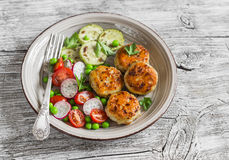 Chicken cutlets,  grilled zucchini  and fresh vegetable salad Stock Photos