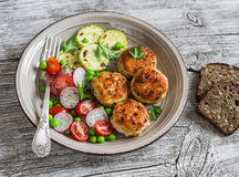 Chicken cutlets,  grilled zucchini  and fresh vegetable salad Royalty Free Stock Photos