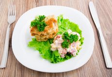 Chicken cutlets with salad on a plate Stock Photo