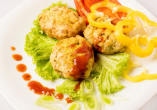 Chicken cutlets on white plate. Chicken cutlets on a white plate with vegetables stock photo