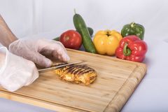 Chicken on cutting board stock photography
