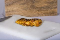 Chicken on cutting board Royalty Free Stock Photography
