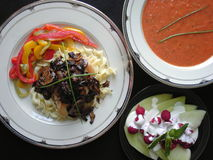 Chicken Dinner. Morel chicken, tomato soup, peppers, and melon dessert for dinner Stock Photo
