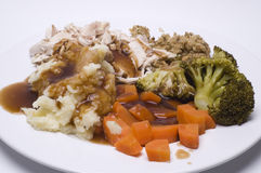 Chicken Dinner. A roast dinner with chicken,carrots,brocolli and sage and onion stuffing Royalty Free Stock Photo