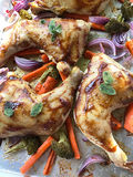 Chicken dinner on baking sheet Stock Images