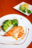 Chicken dish. Chicken breast fillet with broccoli and mashed potatoes on white plates Royalty Free Stock Image