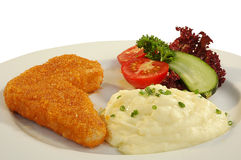 Chicken dish. Chicken chop, mashed potatoes, tomato and cucumber on a dish Royalty Free Stock Photo