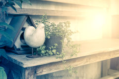 Chicken doll statue and wooden small house Royalty Free Stock Photo