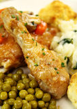 Chicken Drumstick. Baked chicken drumstick with peas and onion  gravy Royalty Free Stock Image