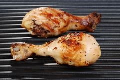 Chicken drumstick on grill Royalty Free Stock Image
