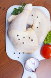 Chicken drumstick. Raw chicken drumstick on white board Stock Photo