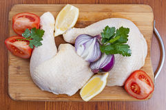 Chicken drumstick. Raw chicken drumstick on wooden board Royalty Free Stock Photo