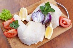Chicken drumstick. Raw chicken drumstick on wooden board Stock Image