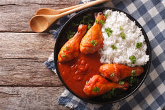 Chicken drumstick with Sriracha chilli sauce and rice garnish. h Stock Photos