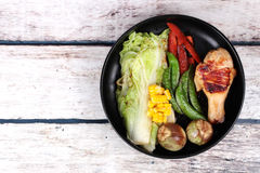 Chicken drumstick steak and grilled mixed vegetables . Royalty Free Stock Photo