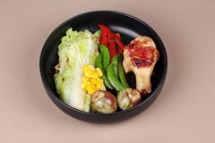 Chicken drumstick steak and grilled mixed vegetables . Stock Photo