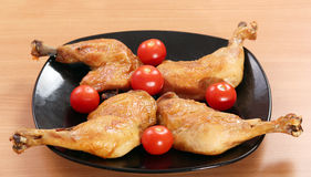 Chicken drumstick and tomatoes Stock Photography