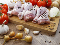 Chicken drumstick with vegetables. On wooden table Royalty Free Stock Photo