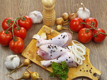 Chicken drumstick with vegetables. On wooden table Stock Photography