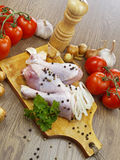 Chicken drumstick with vegetables. On wooden table Royalty Free Stock Photography