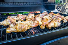 Chicken drumsticks barbecued on the grill Royalty Free Stock Photo