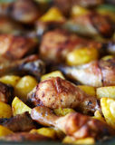 Chicken drumsticks and chips Royalty Free Stock Image