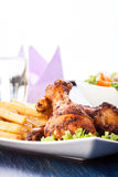 Chicken drumsticks with chips Stock Photography
