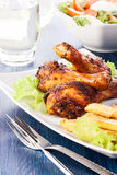 Chicken drumsticks with chips Stock Photo