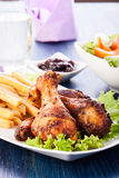 Chicken drumsticks with chips Royalty Free Stock Images