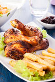 Chicken drumsticks with chips Stock Images