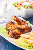 Chicken drumsticks with chips Stock Photos
