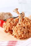 Chicken drumsticks coated with corn flakes Royalty Free Stock Photos