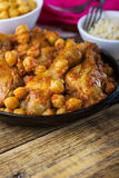 Chicken drumsticks curry with chickpeas and brown rice Stock Photo