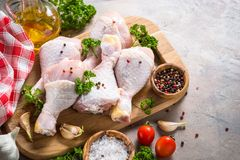 Chicken drumsticks and cooking ingredients. royalty free stock photos