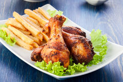 Chicken drumsticks with french fries Royalty Free Stock Photography