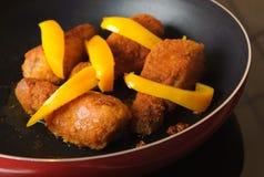 Chicken drumsticks on frying pan. Stock Photo