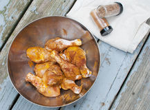 Chicken drumsticks marinating with spices Stock Image
