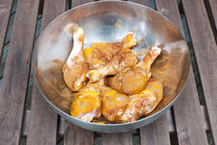 Chicken drumsticks marinating with spices Royalty Free Stock Photography