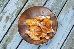 Chicken drumsticks marinating with spices Royalty Free Stock Photos
