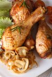 Chicken drumsticks with mushrooms and rosemary vertical top view Stock Image