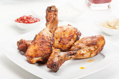 Chicken drumsticks on plate Royalty Free Stock Image