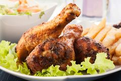 Chicken drumsticks with prepared potatoes Royalty Free Stock Image