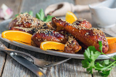 Chicken drumsticks with sesame seeds. Stock Photography