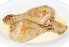 Chicken Drumsticks Stew. Horizontal view of two chicken drumsticks stew on white plate Royalty Free Stock Photography