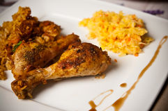 Chicken drumsticks in vegetables with rice Stock Image