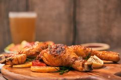 Chicken drumtick in on wood board.  royalty free stock photo