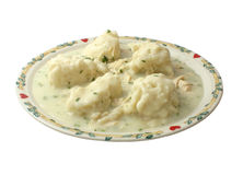 Chicken And Dumplings. Hot plate of chicken and dumpling over white Royalty Free Stock Images